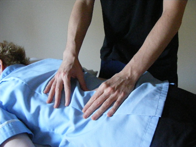Therapist using Bowen Technique therapy on a woman in Glasgow