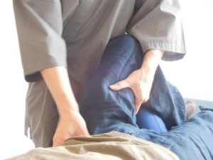 Bowen Technique therapy in Glasgow being performed on a patient